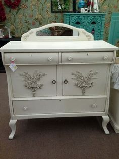 SOLD - This antique oak buffet has been painted creamy white with rose bouquets added to door fronts. ***** In Booth H13 at Main Street Antique Mall 7260 E Main St (east of Power RD on MAIN STREET) Mesa Az 85207 **** Open 7 days a week 10:00AM-5:30PM **** Call for more information 480 924 1122 **** We Accept cash, debit, VISA, Mastercard, Discover or American Express