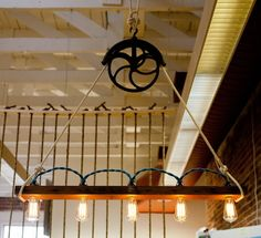 Wood and pulley chandelier with filament bulbs.