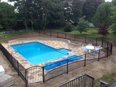 Pool Patio Design 18 x 36 pool... Two tone pavers on patio Cambridge Sandstone and Sahara with Blue Stone coping. 2ft sitting wall. Just finished construction - landscaping next.