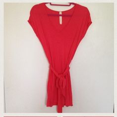 ❤Host Pick❤reduced!  Bright coral top Bright coral top with tie belt. Purchased from Aritzia. Perfect to wear with leggings. Has a small stain on front center of top (please see 3rd photo). Worn twice in great condition. No rips/tears. community - Aritzia  Tops