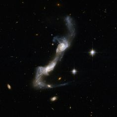 UGC 8335 (also designated Arp is a strongly interacting pair of spiral galaxies, locted about 425 million light-years away in the northeast of the constellation Ursa Major. Galaxy Collision, Solar System Pictures, Spiral Galaxy, Space Photography, Space Images, Space Photos, Image Archive, Galaxy Space, Space And Astronomy