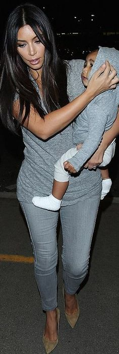 Who made Kim Kardashian's gray skinny jeans and nude suede pumps that she wore at LAX airport