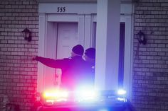 Police stand guard outside a residence of interest during their investigation into an earlier attack at the Ohio State University campus, Monday, Nov. 28, 2016, in Columbus, Ohio. (AP Photo/John Minchillo)