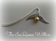 Handmade Harry Potter Golden Snitch bookmark.  The bookmark itself is 8,5cm long, and the charm is 3cm long.  The bookmark is made to order, so