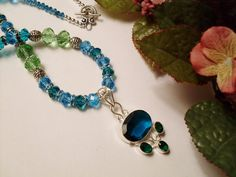 $45.00 - Blue Green Glass Pendant with Blue Green Swarovski Crystal Necklace by #RomanticThoughts on @Etsy!