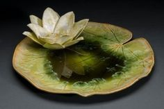 Anne Gary -Lily pad and flower sculpted from porcelain. Crystalline glaze applied to both with flower reflecting in pooling glass crystalline glaze.
