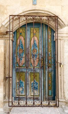 Nevşehir, Turkey……..THE ORNAMENTAL GRILL ON THE OUTSIDE, MAKES IT A GOOD SECURITY DOOR…………..ccp