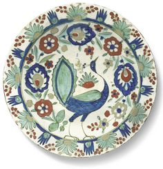 A Kubachi pottery dish with peacock, Persia, Safavid, early 17th century