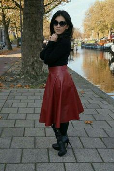Red flared leather midi skirt and boots