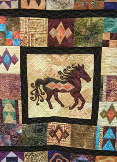 Echoes of the Past/ Southwest Echoes by Norma Suckle, 2013 AZQG.  Design by Elizabeth Anne. Photo by Quilt Inspiration. Amazing southwest horse/pony appliqué.