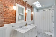 Traditional white bathroom with a brick backsplash - Decoist