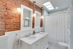 Traditional white bathroom with a brick backsplash - Decoist