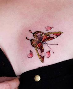 Colorful butterfly tattoo on chest