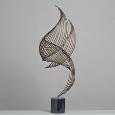 A Large Swirl Metal Table Sculpture by Curtis Jere 1988