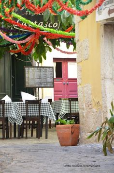 Small traditional restaurants @ Alfama, with tables on the streets, enjoyng the nice wheather Lisbon Portugal
