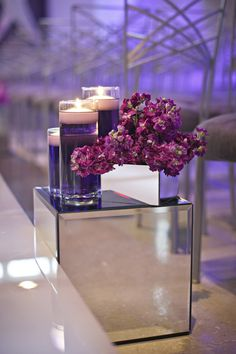 Use our glass vases + floating candles for gorgeous centerpieces. Find them here: http://www.lightsforalloccasions.com/c-411-decorative-vases.aspx
