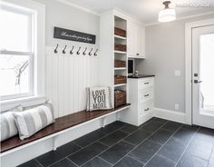 A mudroom or an entryway is usually a small space that needs a lot of storage to hold lots of stuff. We've gathered lots of small mudroom storage ideas for you. Mudroom Laundry Room, Mud Room Lockers, Bench Mudroom, Mudroom Cubbies, Mudrooms With Laundry, Garage Lockers, Built In Lockers, Garage Laundry, Wall Bench