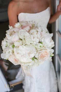 Blush peonies, blush garden roses, white ranunculus, lisianthus and sweet peas