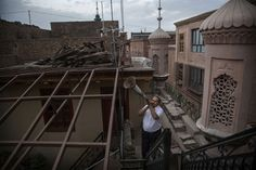 A Uighur Muslim muezzin uses a bullhorn to call the evening prayers on July 2014 in Kashgar. Evening Prayer, Silk Road, Beijing, Louvre, Around The Worlds, City, Prayers, Pictures, Muslim