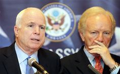 US Senator John McCain (L) speaks as Senator Joseph Lieberman (R) looks on during a press conferences at a hotel in Kuala Lumpur on May 31