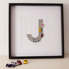 Car track monogram framed.  Cute idea =). Going to make this! @Jessica Baird