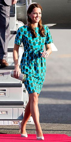 Kate's retro-inspired Jonathan Saunders teal-and-green print sheath, which she accessorizes with nude pumps and a clutch, translates easily to fall with the addition of a black blazer and ankle booties. Pillbox hat optional.