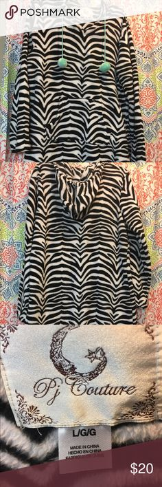 Victoria's Secret warm hooded PJ Victoria's Secret warm hooded PJ. It's soft and warm zebra striped with pom pom on the hoodie strings. Victoria's Secret Intimates & Sleepwear Pajamas