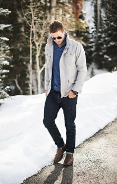 Shop this look on Lookastic: https://lookastic.com/men/looks/field-jacket-shawl-neck-sweater-skinny-jeans/15376   — Blue Shawl Neck Sweater  — Grey Field Jacket  — Dark Brown Leather Watch  — Black Skinny Jeans  — Dark Brown Leather Desert Boots