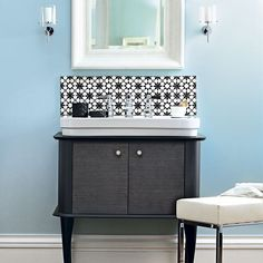 Get the look: Get a vanity unit like this from CP Hart, and wall tiles at TexTiles. Find beautiful bathroom mirrors at Brissi and lights like these at Heal's.    Like the material used on unit