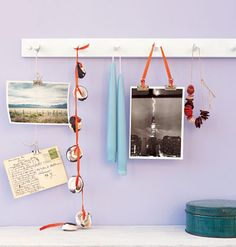 Coat Rack  Display photos and art on a coat rack over the mantel or in a hallway. Use ribbons or strings of different lengths to hang the arrangement from the pegs for an easy and creative change of scenery.