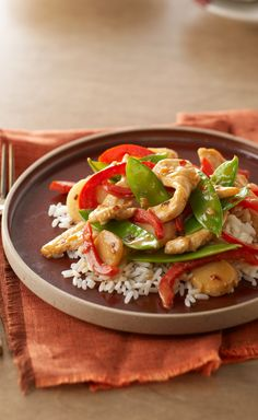 Firecracker Chicken Stir-Fry — Bright with red peppers and snow peas, this Firecracker Chicken Stir-Fry is almost as good-looking as it is delicious!