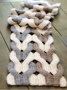 Stitch up a stunning statement scarf! This interesting technique involves working the strips together, then working them separately and repositioning them to make the weave pattern. A comprehensive photo tutorial is included. Knit with approximatel...