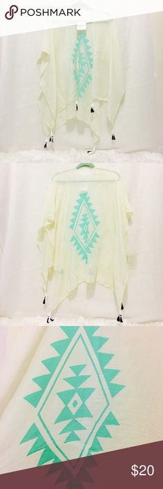 NWT Cream/Teal Kimono- One Size Gorgeous new with tags kimono. Cream with teal design, white and black tassels that hang at bottom as shown in photos. Perfect for the warm weather seasons approaching! Pairs great with jeans or jean shorts. One size fits all. Purchased from an amazing boutique in mid-Michigan. Huge deals in closet right now. Bundle for the best savings!! All offers negotiable :) Athalia's Other