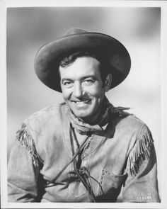 """SANTA FE PASSAGE (1955) - John Payne portrays Indian scout, """"Kirby Randolph"""" - Directed by William Witney - Republic Pictures - Publicity Still."""