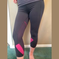 "Lululemon crops. Dark Gray with Pink accents. Great condition. No flaws, snags, holes or pilling. Love the lines and colors and so flattering on.  Hip laying flat from side to side is 15"". Waist 14"" Inseam 21"" lululemon athletica Pants"