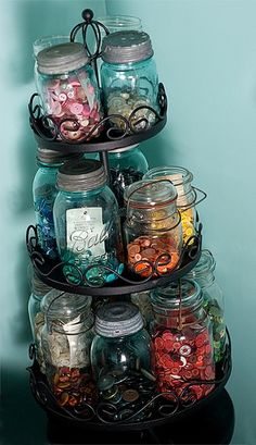 Next to my sewing table is my button storage. This is the best storage solution I've found for buttons. I get to keep them all separated by color and the jars are compactly stored away in a corner rather than taking up an entire table top.