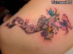 tattoo Borboleta com letras de musica, tatuagem Borboleta com letras de musica