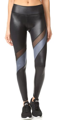 On SALE at 30% OFF! gloss over waves leggings by Beyond Yoga. Coated Beyond Yoga leggings with overlock seams and curved mesh gussets. Covered elastic waistband. Fabric: Coated je...