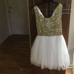 Beautiful gold and white dress New prom gold and white dress.. Can be worn for any function. Dresses Prom