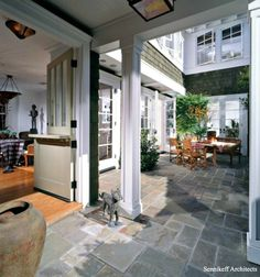 gorgeous stone courtyard surrounded by French doors...love the stone