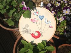 """Machine embroidery and applique  6"""" hoop with a bird design."""
