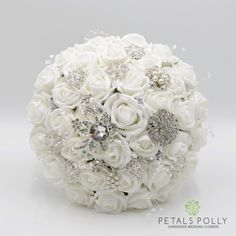 This white brides posy is made with quality artificial roses, diamante brooches, pearl stems and crystal stems. We can make a complete matching range in this design and colour.  Size – Choose your preferred size above.  We can make all of our products in all of our colours or can be made to your own size, design and colours. Please use the Request a Custom Order link above.  Please see more of our range at our Etsy store: https://www.etsy.com/uk/shop/PetalsPollyFlower...