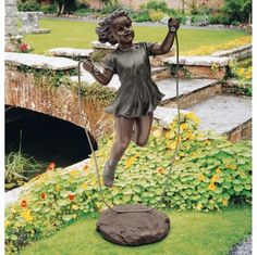 "A Memory Captured in Time Sculpture  20""Wx16½""Dx48""H. 58 lbs.  Cast in quality designer resin, and finished in a faux verdigris bronze patina, it is virtually indistinguishable from a gallery bronze. http://www.designtoscano.com/product/garden+statues/sale+garden+statues/a+memory+captured+in+time+sculpture+-+ky1136.do?sortby=bestSellers"