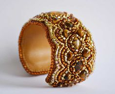 http://cdn.shopify.com/s/files/1/0752/7947/products/brown-beaded-cuff.JPG?v=1422395404