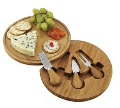 The round Feta cheese board set is made of natural bamboo wood. Complete with a hidden swivel base and three stainless steel serving utensils with bamboo handles. Convenient compact size and juice groove detail. Cheese Board Set, Picnic At Ascot, British Traditions, Bamboo Board, Serving Utensils, Kitchen Gadgets, Kitchen Stuff, Kitchen Products, Kitchen Utensils