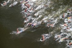 A general view as Keri-Anne Payne (C) of Great Britain leads the field away from the start in the Women's 10km Open Water Swimming Final