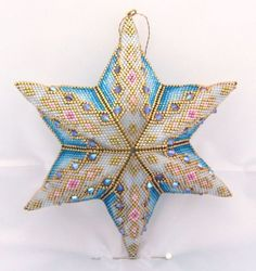 Star adapted from a peyote triangle pattern by Cris Rugar Jewelry Patterns, Beading Patterns, Triangle Pattern, Beaded Ornament Covers, Peyote Stitch Patterns, Beaded Boxes, Beaded Christmas Ornaments, Beaded Crafts, Peyote Stitch