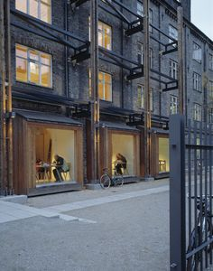The Neighbourhood Centre (Copenhagen, Denmark) is a former industrial building from 1880. Today it was been transformed into a modern local library and a café.