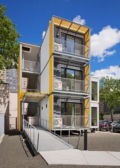 """Modular New York homes by Garrison Architects to """"create a blueprint for post-disaster housing"""" Container Architecture, Container Buildings, Modular Housing, Modular Homes, Emergency House, Casas Containers, New York Homes, Shipping Container Homes, Shipping Containers"""
