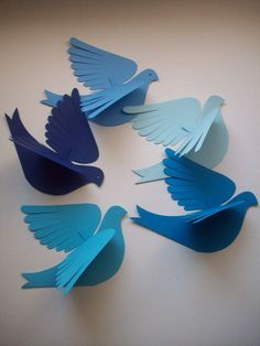 Five sweet cardstock paper birds in shades of blue to attach to a wall or hang as a mobile. Great feather-cut wings, face profile with punched eye and forked tail. Each bird is cut from doubled cardstock so the wings spread outward in flight. Bend the wings the way you like. Each bird